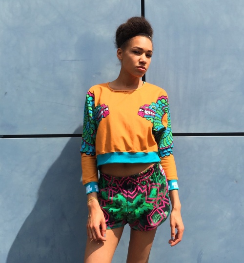 Tribe Dragons Cropped Sweater by Dream Nation -I'm loving the combination of the dragonesque motif of the Mayan deity Kukulkan, with fantastically vibrant colour palette! Made from 95% organic cotton